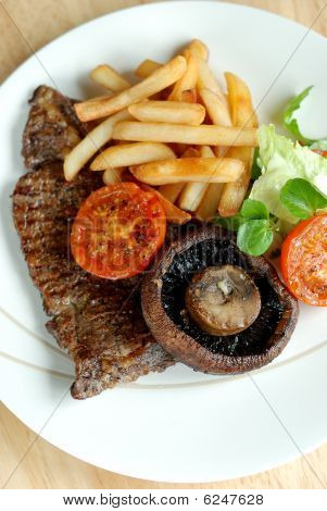 Beef steak with chips and salad