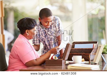 Grandmother Showing Document To Grandson