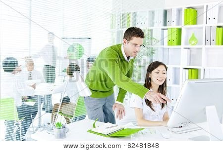 Young Business People Working Together in Green Office