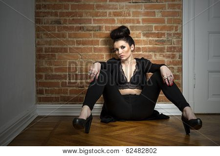 Moody Elegant Woman Sitting On A Parquet Floor
