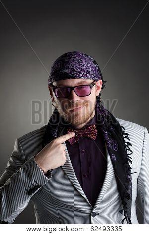 Stylish middle-aged showman posing at camera