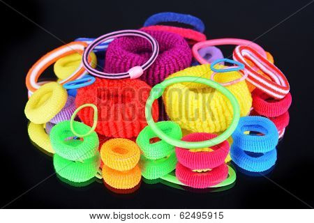 Colorful scrunchies isolated on black