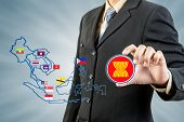 ASEAN Economic Community in businessman hand for any use poster