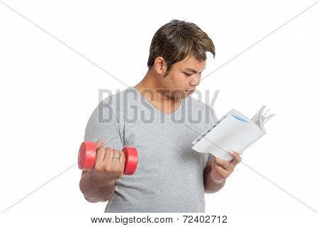 Asian Man Reading A Book With Red Dumbbell