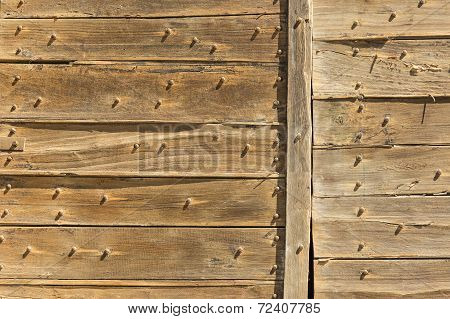 Wall covered with old planks.