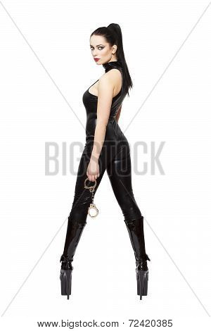 Woman in latex catsuit and high heel platform boots holding handcuffs bdsm isolated on white background poster
