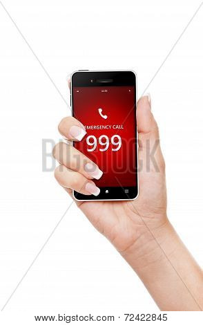 Hand Holding Mobile Phone With Emergency Number 999