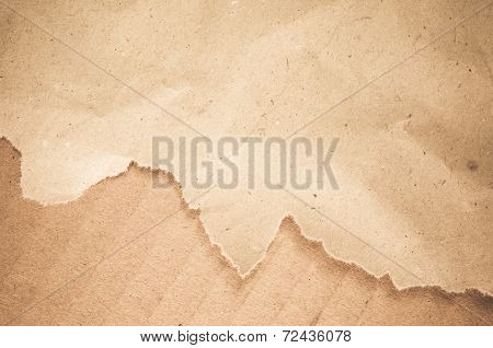 a shet of torn paper on a cardboard surface poster