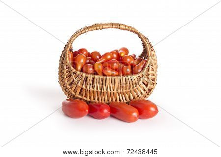 Red tomatoes in a basket isolated on vhite background