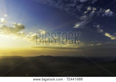 Breathtaking Sunset Over The Valley With Prominent Rays