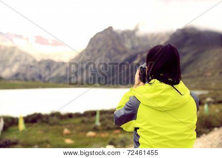 woman photographer taking photo at tibet,china