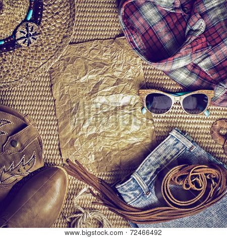Accessories cowboy retro style on wooden background with blank vintage poster