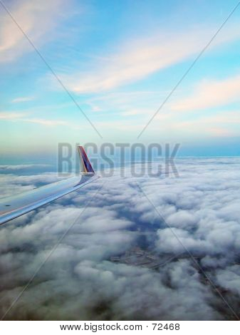 Airplane Wing, Clouds And Sky