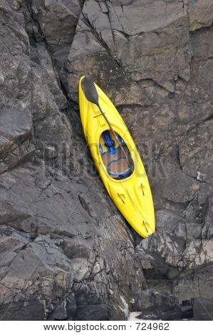 Yellow Kayak On The Rock
