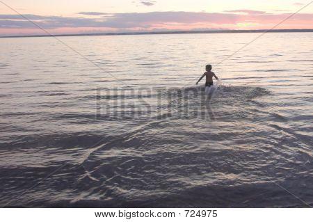 Boy On The Evening Beach