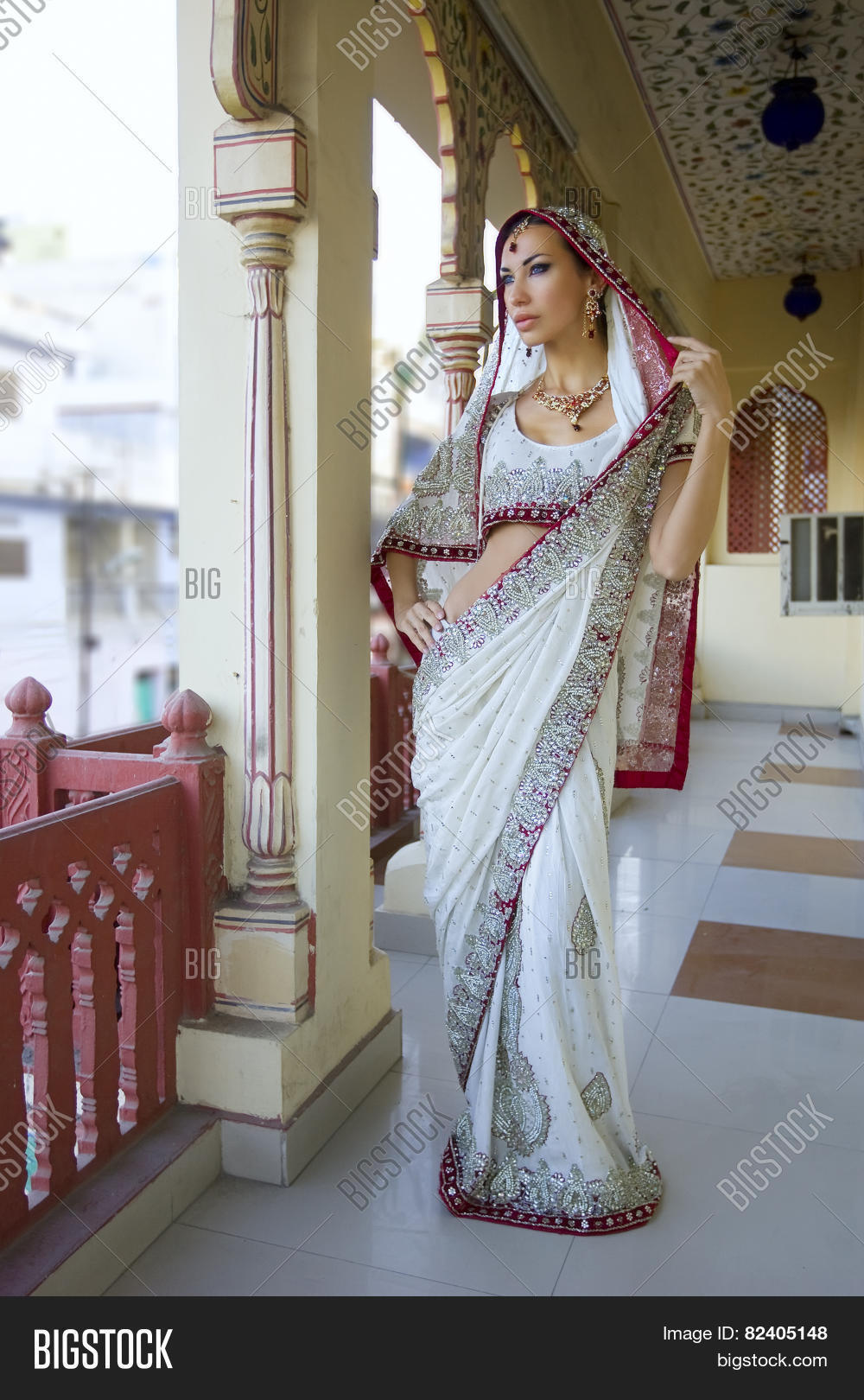 0ee63bcd31 Beautiful Young Indian Woman In Traditional Clothing With Bridal Makeup And Oriental  Jewelry.
