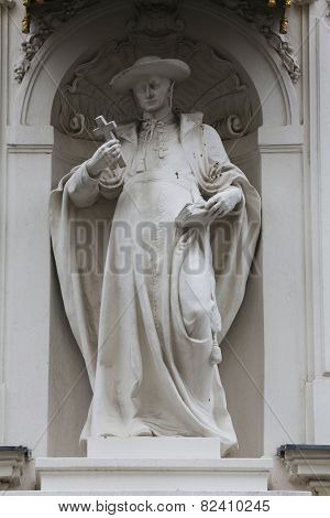 VIENNA, AUSTRIA - OCTOBER 10: Saint Charles Borromeo, detail from the house of the Knights of the Cross with the Red Star on October 10, 2014 in Vienna.