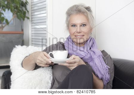 An image of a best age woman with a cup of coffee