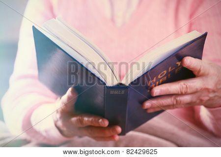 Old woman reading Bible, closeup