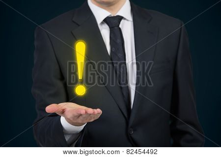 Man Holding Exclamation Mark