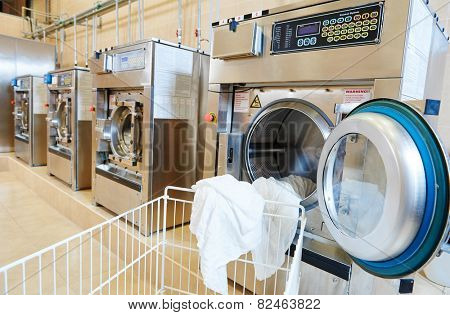 line of industrial laundry machine in laundrette