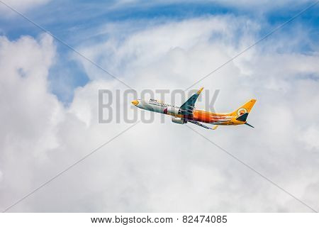 PHUKET , THAILAND- OCTOBER 25, 2014: Nok air plane takes off from Phuket International Airport. Nok Air was founded in February 2004. Nok Air has opened its first international route May 31, 2007