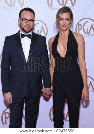 LOS ANGELES - JAN 24:  Dana Brunetti & Katie Cassidy arrives to the 26th Annual Producers Guild Awards  on January 24, 2015 in Century City, CA