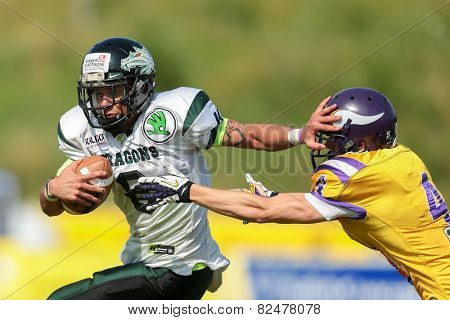 VIENNA, AUSTRIA - JULY 14 QB Jonathan Dally (#8 Dragons) and DB Benjamin Bubik (#4 Vikings) fight for the ball at the playoffs of the AFL on July 14, 2013 in Vienna, Austria.