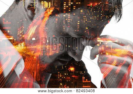 Desperate man on night city blurred lights
