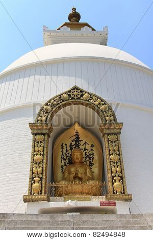 POKHARA, NEPAL - APRIL 2014 : Golden Buddha statue housed in Pokhara Shanti Stupa, World Peace Pagoda on 15 April 2014 in Pokhara, Nepal. Shanti Stupa was built in 1996 as a symbol of peace.
