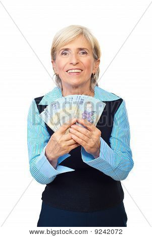 Excited Senior Showing Romanian Money