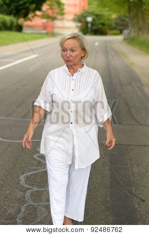 Adult Woman In All White Walking At The Street