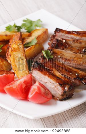 Roasted Spareribs, Potatoes And Tomatoes Closeup. Vertical