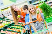 Family selecting fruits and vegetables while grocery shopping in supermarket  poster