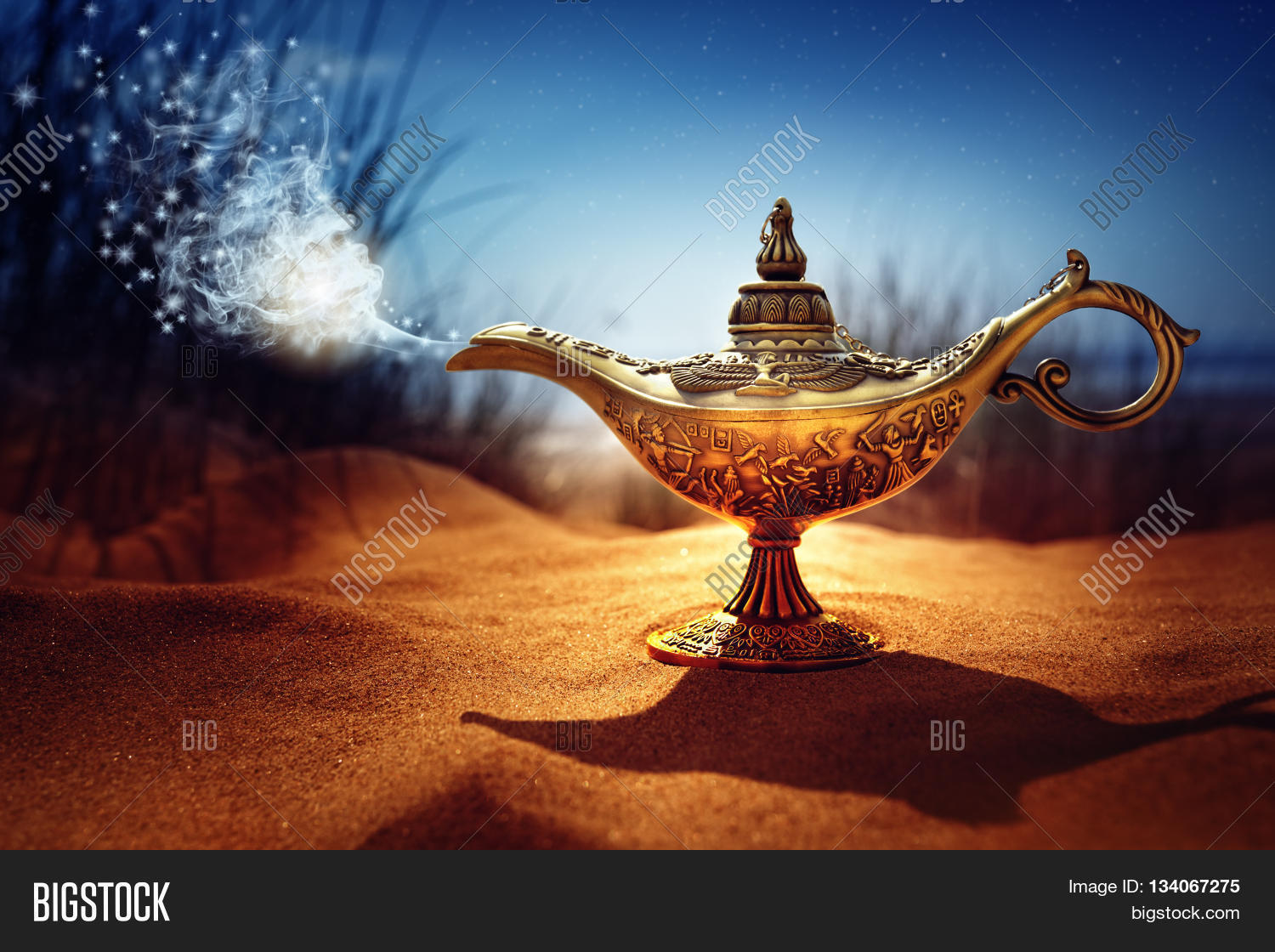 Magic Lamp In The Desert From The Story Of Aladdin With Genie Appearing In  Blue Smoke