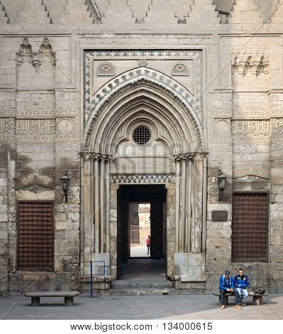 Cairo, Egypt - December 12, 2015: Entrance of theological school and Mausoleum of Sultan Qalawun Moez Street