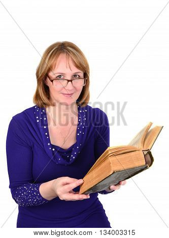 leisure literature and people concept - middle aged woman in glasses reading book isolated on the white background.
