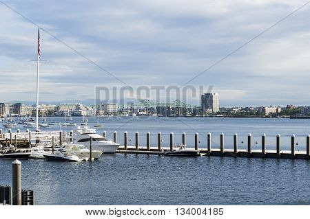 Boston Massachusetts USA - June 9 2016: View across Boston harbor from South Boston to Tobin Bridge and East Boston
