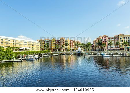 Colorful Spanish Influenced Buildings Overlooking The Water In Tropical Naples Florida .