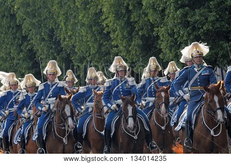 STOCKHOLM - JUN 06 2016: The Royal guards in blue uniforms on the horse back protecting the swedish royal family on their way to celebrate the swedish national day