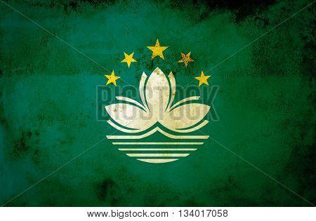 Macau flag on grunge paper texture background