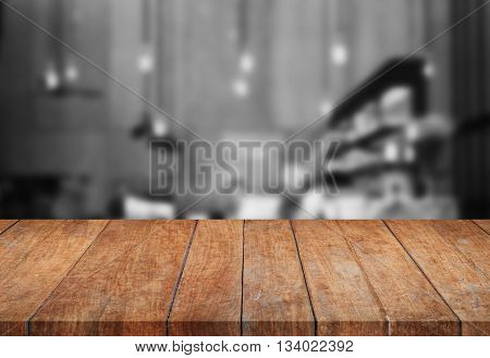 Perspective wooden tabletop with black and white background, stock photo