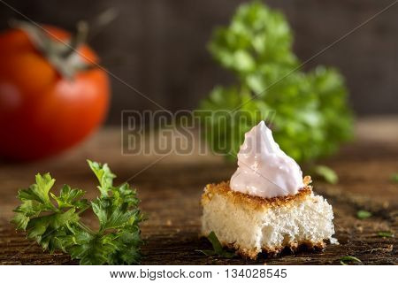 Roe salad appetizer with bread and herbs over wooden background poster