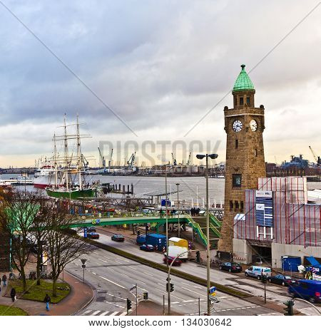 HAMBURG, GERMANY - JUNE 3, 2011: view to Landungsbruecken in Hamburg with river Elbe
