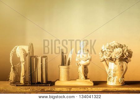 Decorative at home and vase flower on wood.