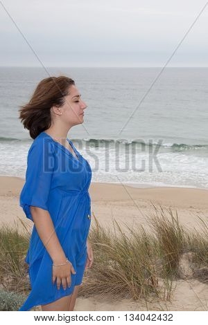 Girl Enjoying Wind, Breathing Fresh Air On Beach, Feels Free