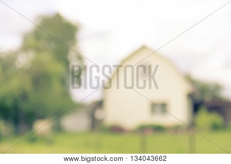 Blurred abstract countrified background with house outdoor in summer village copy space lens blur