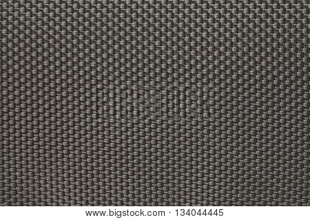 the solid background of a gray carbon fiber