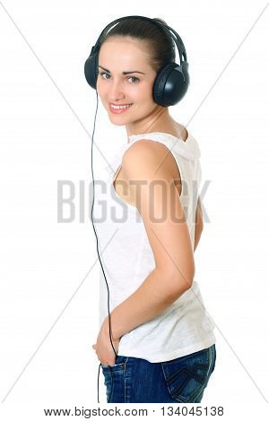 young woman with dark hair standing, posing with headphones. Half-lenght portrait on white background, isolated
