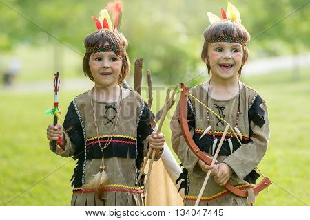 Cute Portrait Of Native American Boys With Costumes, Playing Outdoor In The Park